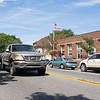 Joseph Weiser | The Goshen News <br /> A truck passes in front of the Middlebury Post Office Monday afternoon along Main Street.
