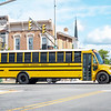 Goshen Community Schools school bus travels through the intersection of East Lincoln Street and Fifth Street Monday morning in Goshen. Monday was the first day of in person classes for Goshen Community Schools.