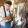 Blacksmith James Rubley showcases a pitch fork Wednesday at his shop in Shipshewana that was made from blacksmithing.