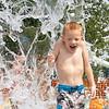 Damien Lanzen, 4, of Goshen, gets drenched at the splash pad Monday afternoon at Pringle Park in Goshen.