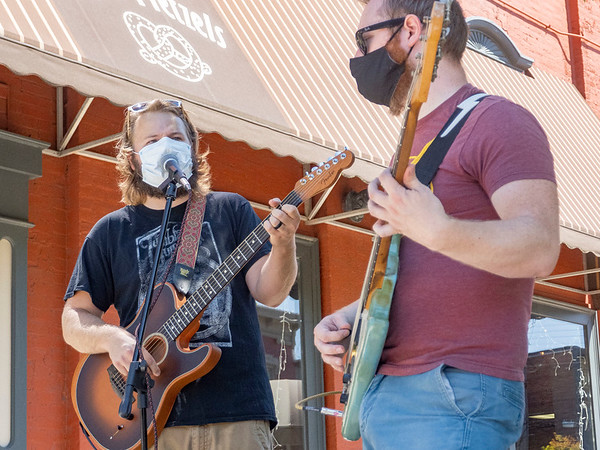 McLane & Company musicians Michell McLane, left, of Goshen, and Nicolas Leatherman perform outside JoJo's Pretzels Friday afternoon in Goshen. The band has an upcoming concert at Goshen Brewing Company September 23.