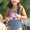 Aleaha Steiner, 9, of Goshen, plays  in the splash pad Monday afternoon at  Rieth Park in Goshen.