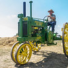 Ernie Shupp, of Nappanee, drives a vintage John Deer tractor Saturday during the Wakarusa Vintage Power Show in Wakarusa.