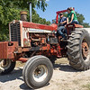 Heston Wallace, left, of Dowagiac, Michigan, drives a vintage Farmall tractor with Hilary Kiser, of Warsaw, Saturday during the Wakarusa Vintage Power Show in Wakarusa.
