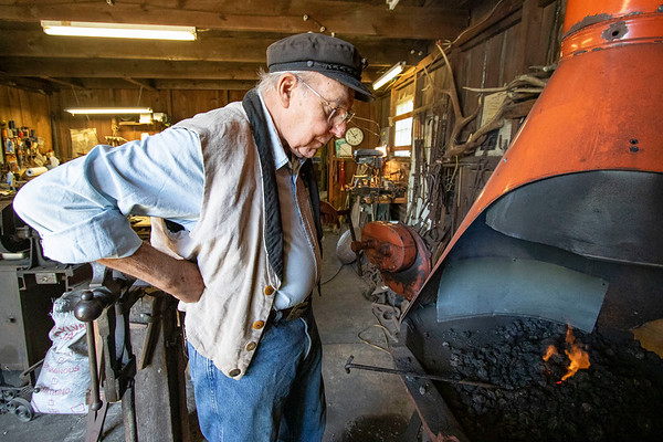 Blacksmith James Rubley  builds his fire in a blacksmithing forge Wednesday at his shop in Shipshewana.