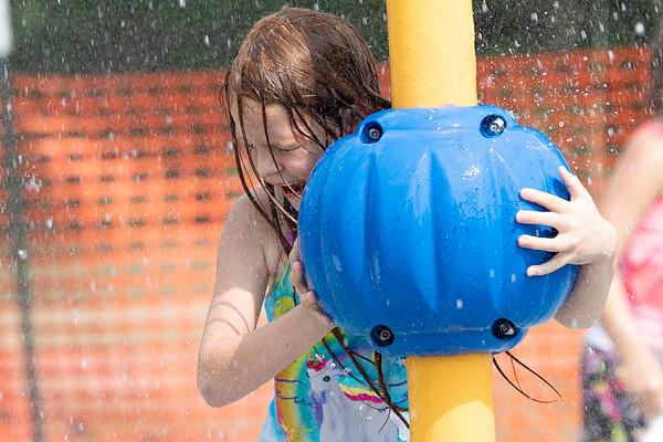 Serenity Lanzen, 6, of Goshen, plays in a splash pad Monday afternoon at Pringle Park in Goshen.