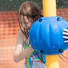 Serenity Lanzen, 6, of Goshen, plays in a splash pad Monday afternoon at Pringle Park in Goshen.