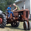 Josh Gentz, left, of Goshen, gets help driving a tractor by Terry Tentz, of Woodburn, Indiana, Saturday during the Wakarusa Vintage Power Show in Wakarusa.