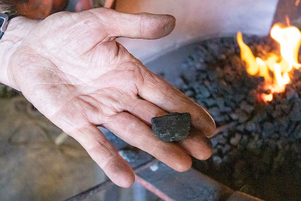Blacksmith James Rubley showcases a piece of coal before turning into coke Wednesday at his shop in Shipshewana that was made from blacksmithing.