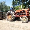 Rober Scheets, of Milford, drives a vintage Massey Harris tractor in a tractor pull Saturday during the Wakarusa Vintage Power Show in Wakarusa.