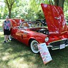 John Kline | The Goshen News<br /> Vicky Thompson, of Goshen, stands next to her red 1957 Ford Thunderbird during the fifth annual Classic Car Cruise In at the Elkhart County 4-H Fairgrounds Saturday afternoon.