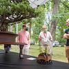 Michiana Bonsai Study President Larry Benjamin, center, speaks with Jayson Margush, left, and Jeff Margush Saturday, Aug. 1 at Wellfield Botanic Gardens during the Bonsai Show in Elkhart.