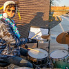 Concord High School student Handro Spradling, of Goshen, plays the drums during Thursday's Santa's Workshop Drive-Thru at Concord High School in Elkhart.