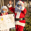 Concord High School students Emma Gingerich, 17, of Elkhart, and John McEachern, 17, of Goshen, jingle to the band playing during Thursday's Santa's Workshop Drive-Thru at Concord High School in Elkhart.