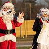 Concord High School students John McEachern, 17, of Goshen, left, and Emma Gingerich, 17, of Elkhart, jingle to the band playing during Thursday's Santa's Workshop Drive-Thru at Concord High School in Elkhart.