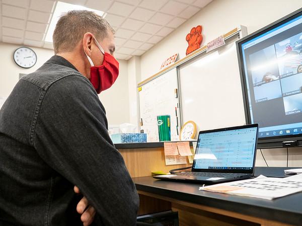 Goshen High School freshman science teacher Matt Katzer speaks with his students about grades through zoom Monday afternoon at Goshen High School in Goshen.