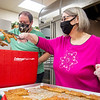 Volunteers Deb Roe and her husband Rob Roe, both of Goshen, prepare sausages Saturday for the First Presbyterian Church After Christmas Day Brunch at First Presbyterian Church in Goshen.