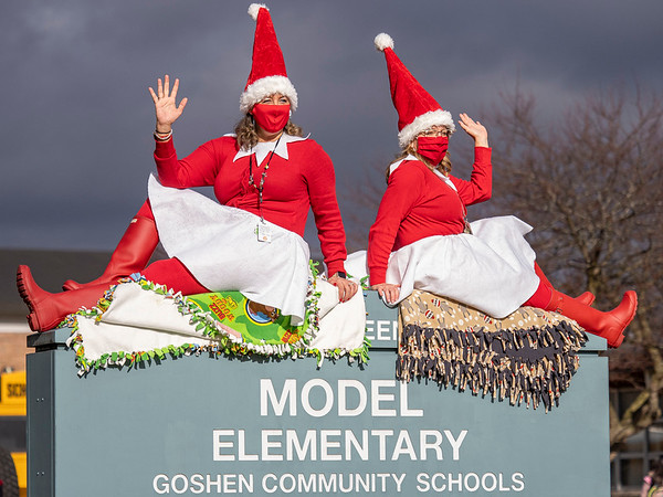 Model Elementary Principal Tami Hicks, left, and Assistant Principal Krista Troyer spread holiday cheer Tuesday as they send off their students on holiday break at Model Elementary in Goshen. Goshen students return from holiday break Jan. 6, 2021.