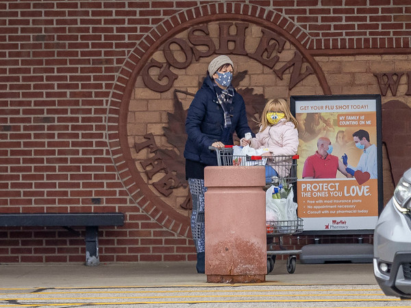 Tina Yoder, left, and Sara Marie Yoder, 6, of Goshen, walks out of the Martins Super Market Tuesday afternoon located at 1527 Bashor Rd, Goshen.
