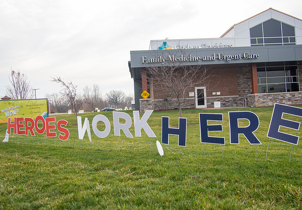 """A """"Heroes Work Here"""" sign sits in front of the Goshen Physicians Family Medicine and Urgent Care Friday afternoon located at 2824 Elkhart Rd. in Goshen."""