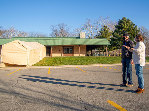 Center for Healing & Hope executive director Missy Schrock, right, speaks with volunteer Don Jantzi about plans for the new COVID-19 testing site in front of the Schrock Pavilion Wednesday afternoon at Shanklin Park in Goshen.
