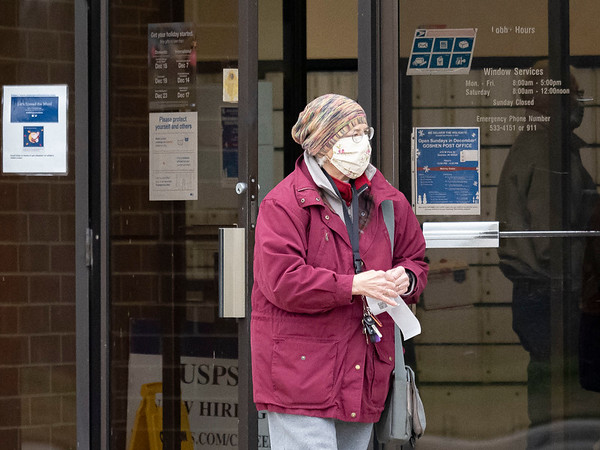 Victoria Waters, of Goshen, walks out of the Goshen Post Office Tuesday afternoon in Goshen.