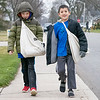 Israel Jenkins, 7, left, and Isaiah Jenkins, 9, both of Nappanee, deliver papers on their paper route along West Van Burnen Street in Nappanee.