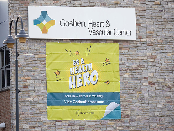 """A """"Be A Health Hero"""" sign is attached to the side of the Goshen Heart & Vascular Center building Friday afternoon at1855 S. Main St., Ste. A in Goshen."""