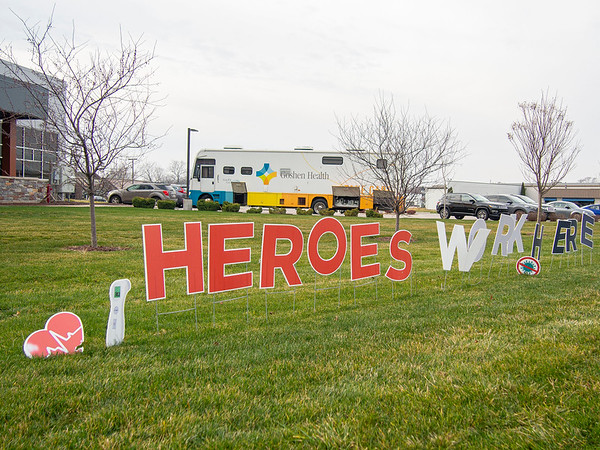 """A """"Heroes Work Here"""" sign sits in front of Goshen Physicians Family Medicine and Urgent Care at 2824 Elkhart Road in Goshen."""