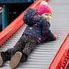 Ava Wingard, 2, of Goshen, slides backwards down a slide at Hay Park Monday afternoon. Hay Park is located at 1524 Hay Pkwy., Goshen.