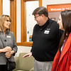 From left, Beth Curtis, of 1st Source Bank, speaks with Ancon Construction Chief Finical Officer Rhett Fisher and Ancon Construction Brand Manager Marissa Odom during the 1st Source Bank ribbon cutting ceremony Thursday at their new location located at 809 W. Wayne St., Middlebury.