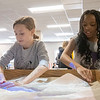 From left, Kennedy Trexler, 10, and Kailey Britman, 10, both of Elkhart, work with the topographic sandbox Saturday at Ethos Innovation Center in Elkhart.