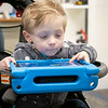 Wilder Simpson, 2, of South Bend,  uses a tablet to control a Lego robot Saturday at Ethos Innovation Center in Elkhart.