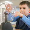 George Skaggs, 6, of South Bend, plays with a plasma ball Saturday at Ethos Innovation Center in Elkhart.