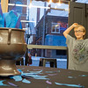 Anthony Moyes, 9, of Dunlap, reacts after tossing his name into the Goblet of Fire to enter the TriWizard Tournament at Fables Books Thursday evening during the Harry Potter Book Night.