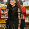Anna Smucker, 10, of Goshen, casts the summons spell at Fables Books Thursday evening during the Harry Potter Book Night.