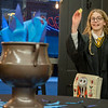 Lorelei Shively, 11, of Goshen, tosses her name into the Goblet of Fire to enter the TriWizard Tournament at Fables Books Thursday evening during the Harry Potter Book Night.