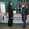 John Kline   The Goshen News<br /> Marie Smith, of Michigan, left, and Melissa Gunter, of South Bend, chat while volunteering at the South Bend-Elkhart Audubon Society booth during the annual Elkhart County Garden Expo at the Northern Indiana Event Center in Elkhart Saturday morning.