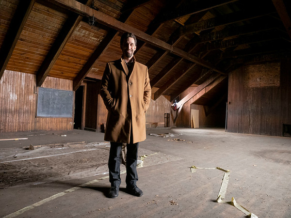 Goshen Mayor Jeremy Stutsman poses for a photo in the original Goshen high school gym. The city Annex building is in the original Goshen High School built in 1904 located at 204 E. Jefferson St., Goshen.