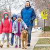 Parkside Elementary first graders Sophie Yoder Schlabach, 7, left, Caleb Yoder Schlabach, 7, left back,  and Jasmin Gillette, 7, middle walk home from school Friday with Brian Yoder Schlabach, all of Goshen, and his golden doodle down eighth street.