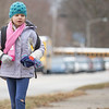Parkside Elementary second grader Poppy Haberck, 7, of Goshen, walks along the sidewalk down eighth street after school Friday.