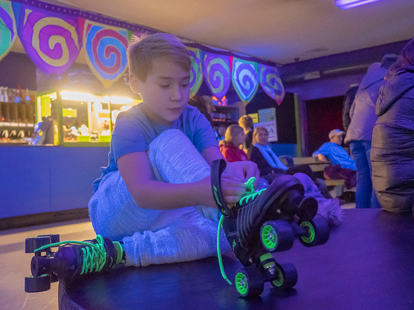 Jacob Hunter, 9, of Goshen, ties his laces on his skates during the Heritage Intermediate School Skating Night at Eby's Family Fun Thursday. Eby's Family Fun is located at 14583 State Road 120, Bristol. Services offered are roller skating, arcade games, and laser tag.