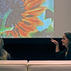 Gabe Miller | The Goshen News<br /> Amanda, right, shares stories of detained migrant children with attendees in the Art House theater.