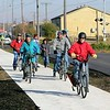 John Kline | The Goshen News<br /> Community members take a ride on the newly-completed Ninth Street Corridor Bike and Pedestrian Trail following the project's grand opening celebration at Goshen's Water Tower Park in this file photo from November 2019. The Goshen Redevelopment Commission's recently updated five-year project funding plan now includes a project that would add new sidewalks and repair existing sidewalks along the Ninth Street corridor, along with numerous other new projects.