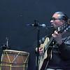 Gabe Miller | The Goshen News<br /> Nayo Ulloa, a Peruvian-born multi-instrumentalist from Goshen, performs at Amanda's gallery opening  Saturday.