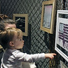 Gabe Miller | The Goshen News<br /> Lauren Gettinger and her daughter, Lucy, look at paintings by Juuust Amanda.