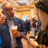 """Elkhart City Councilman Arvis Dawson, left, speaks with Get-Bronzed Spray Tanning owner Kim Rodabaugh during """"The Big Event"""" at the Lerner Theatre in Elkhart Wednesday."""