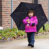 Belén Stolezfus-Murillo, 2, of Goshen, walks to the Goshen Public Library on a rainy Friday afternoon with her aunt Johnna Buller. The library is located at 601 S. Fifth St.