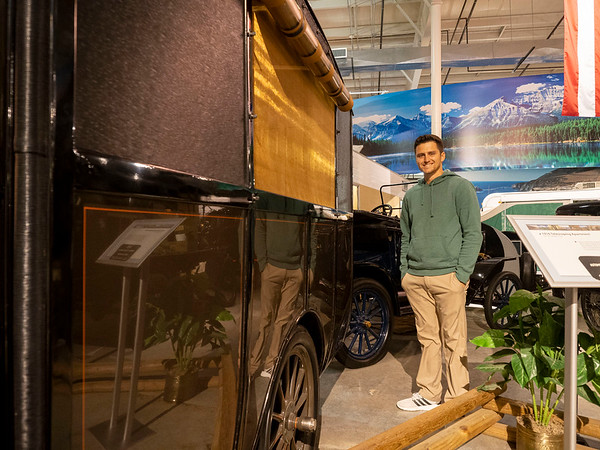 RV/MH Heritage Foundation, Inc. Vice President Ryan Szklarek poses for a photo with a 1916 Telescoping Apartment at the RV/MH Hall of Fame Tuesday.