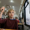 """Caleb Yoder Schlabach, 7, of Goshen, uses a thermometer to take the temperature of the air during the Ethos Innovation Center """"Science 2 Go"""" class on liquids, solids, and gasses Monday at Parkside Elementary."""